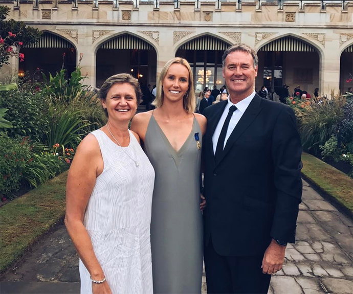 Emma with her parents, Susie and Ron, who couldn't be more proud.