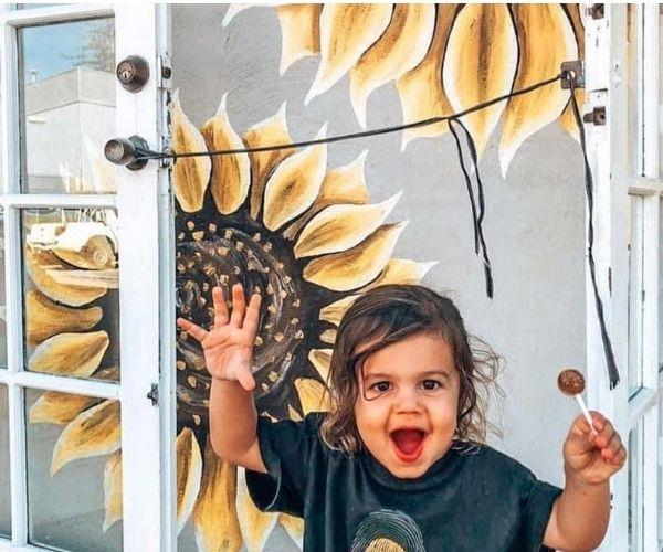 My son, Kala, loves sunflowers too (Image: supplied)