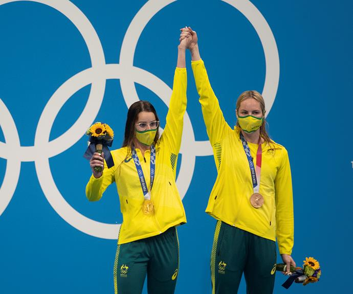 Kaylee McKeown brought bronze medallist Emily Seebohm up onto the top podium during the medal ceremony.