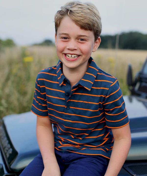 Prince George grins in a photo released to mark his eighth birthday.