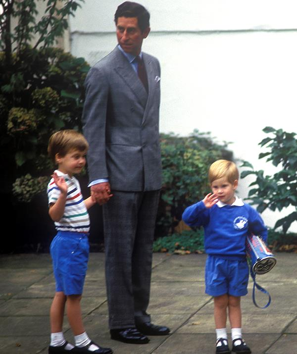 Charles was photographed holding a young William's hand as he dropped his sons off on Harry's first day at Mrs Mynors' nursery school in London, September 1987.