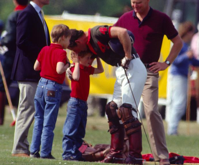 In 1990 Charles was pictured planting a kiss on Harry's head as William watched on. The photo was snapped at a polo match where the Prince of Wales was playing.