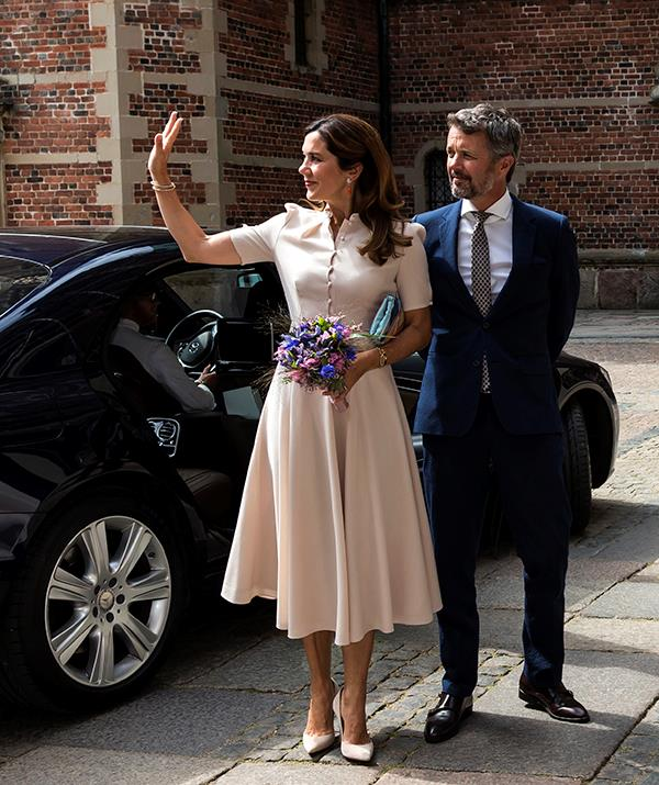 **June 2020, Denmark** <br><br> Mary donned a sleek a-line dress for the opening of an art exhibition celebrating Queen Margrethe II of Denmark in June, 2020. Featuring a belted waist, button-up neckline and demure short sleeves, Mary looked radiant in the cream Belulah style, which she paired with matching pumps and a contrasting clutch.