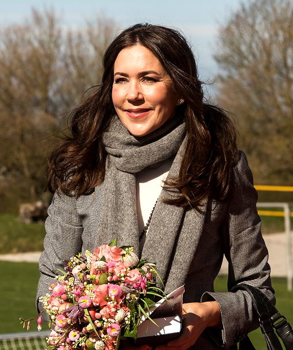 **April 2021, Denmark** <br><br> Mary also donned a co-ordinating scarf during her visit and was presented with a blush pink bouquet of flowers that added the perfect pop of colour to her monochromatic look.