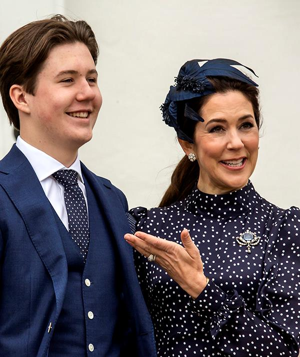 **May 2021, Denmark** <br><br> The proud mum made sure her outfit complimented her son's navy suit on his important day, and Prince Christian even wore a polka dot tie that matched Mary's dress. The Crown Princess also wore a family heirloom brooch known as the Connaught sapphire brooch, which has been in the Danish royal family since the 1870s.