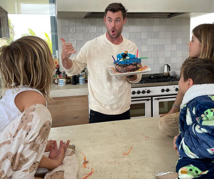 Chris throws up a shakka with his surfing-inspired cake.