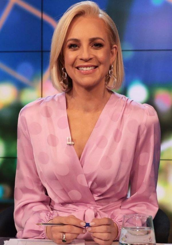 Tickled Pink! Carrie looks romantic in this satin polka dot dress, which is accentuated by long flowing sleeves and a cascading neckline.