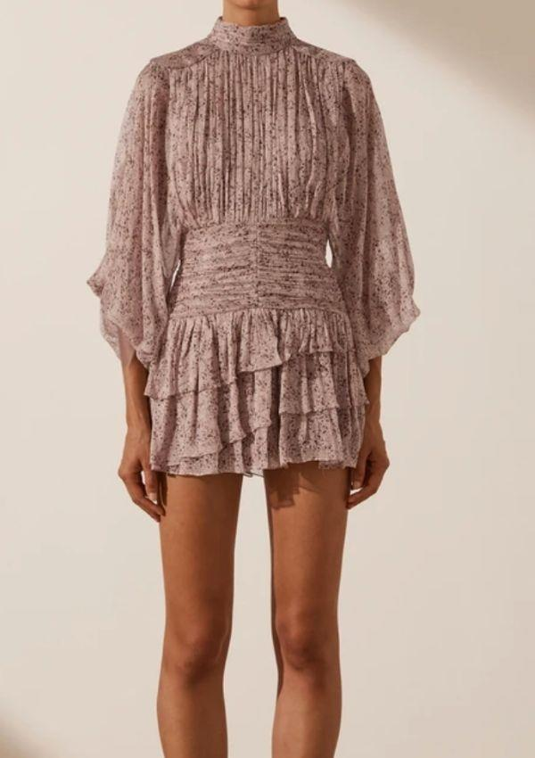 """While Carrie wore an exclusive colour for her appearance on The Project, you can still buy Shona Joy's Paulette Long Sleeve Ruched Mini Dress in its Paulette print and rose brown. Buy it online [here.](https://shonajoy.com.au/products/paulette-long-sleeve-ruched-mini-dress-rose-dust-multi target=""""_blank"""")"""