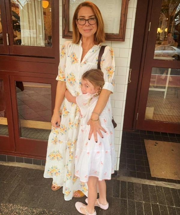 The mother and daughter duo are twinning in their floral summer dresses.