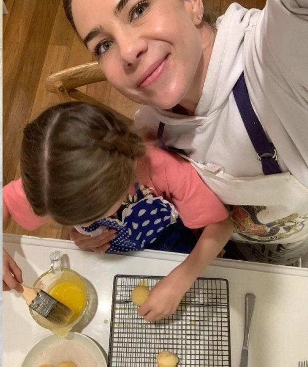 """Here they are working on a Donna Hay cinnamon scroll recipe. """"Was happy to play Sous-Chef to this little monkey in our house this afternoon! 👩🏼🍳💗👩🏼🍳 Thank you,"""" the radio host mused."""
