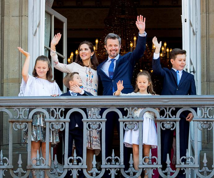 Princess Isabella (left) waves from a balcony with her parents and siblings in 2018.