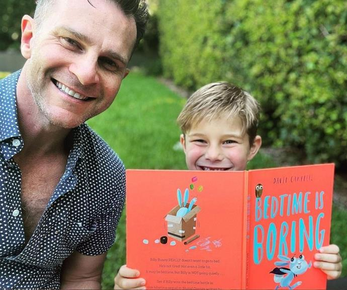The singer, actor and performer has added author to his resume with a series of children books. <br><br> Here the proud father is pictured reading with his son Billy.