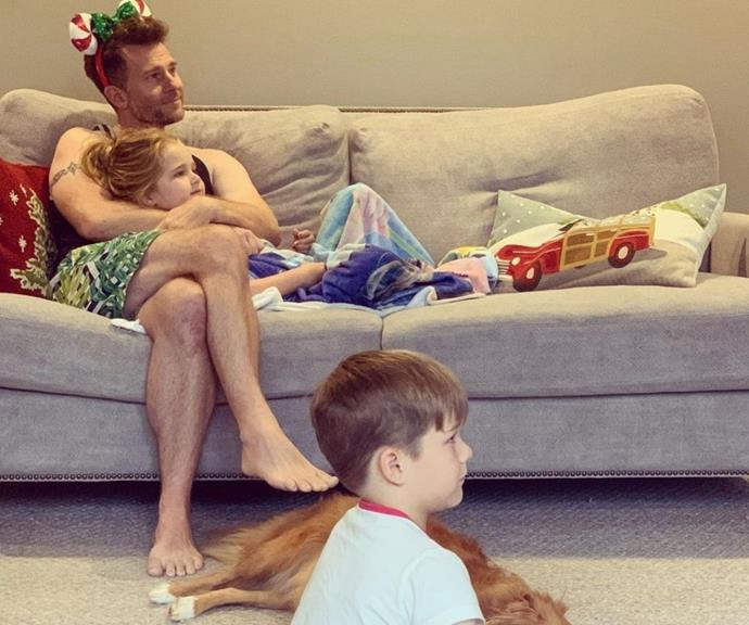 Christmas with family is the best kind of festive vibe. Here David is snuggling on the couch with Betty while Leo sits on the floor as they watch TV together.