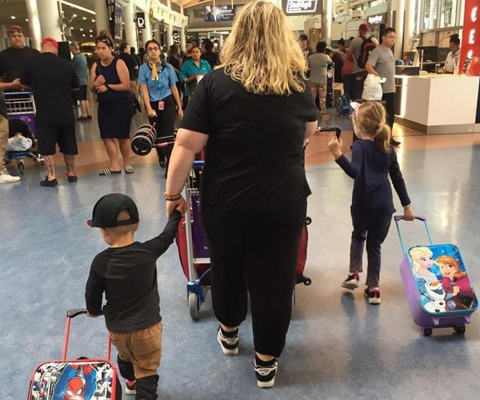 The comedian with her children at an airport.