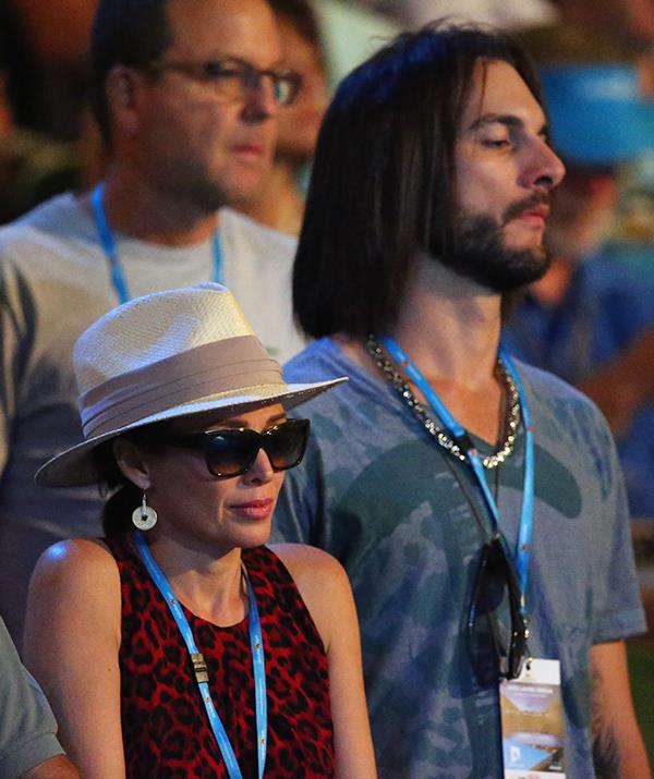 Dannii and Adrian were photographed at the Australian Open in 2014.