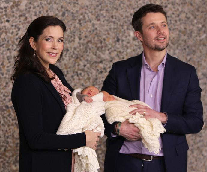 The proud parents cradle their twin newborns after Mary gave birth in 2011.