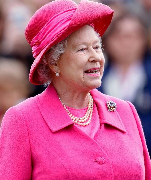 **Queen Elizabeth** <br><br> The Queen is wearing an intensely bright pink lipstick, which she delightfully styled with her monochromatic outfit. Her look is totally campy, and it proves the Queen knows how to have fun with beauty and fashion.