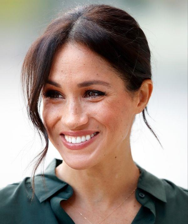 **Meghan Markle** <br><br> Meghan has a penchant for smokey eyes, which is always better off paired with a nude lip. Here her lipstick is on the darker side, and Meghan's expertly matched it with her blush for a monochromatic finish.