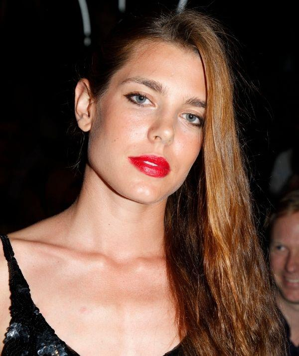 **Charlotte Casiraghi** <br><br> Charlotte's lipstick look for fashion week is a vibrant and seductive red, which is phenomenal on her famous pout. This aesthetic is a statement, so it's great for lipstick experts. However, for those starting out, don't fret! You can build your way up to this level of fierce.