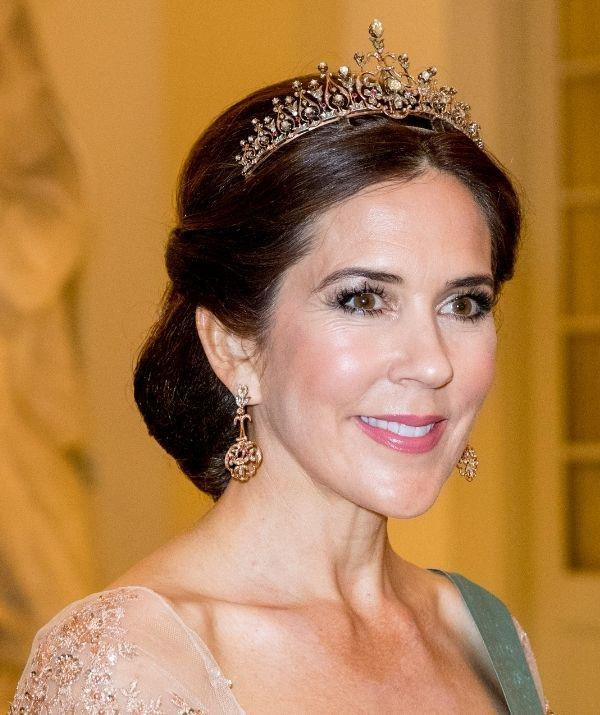**Princess Mary** <br><br> Mary loves her nudes, but this look has a peachy pink tone that lights up her face and creates a youthful finish. It's a shade that can go with every outfit.
