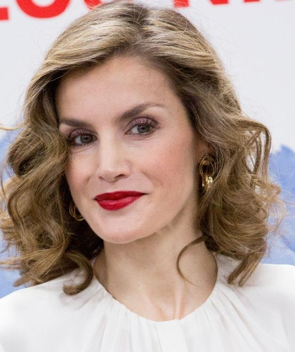 **Queen Letizia** <br><br> Queen Letizia is a very glamorous woman, and as a member of the Spanish royal family, she is allowed to experiment with bold lips. Her dark red lipstick in this picture is so regal and captivating that it makes an excellent argument for the power of red lips.