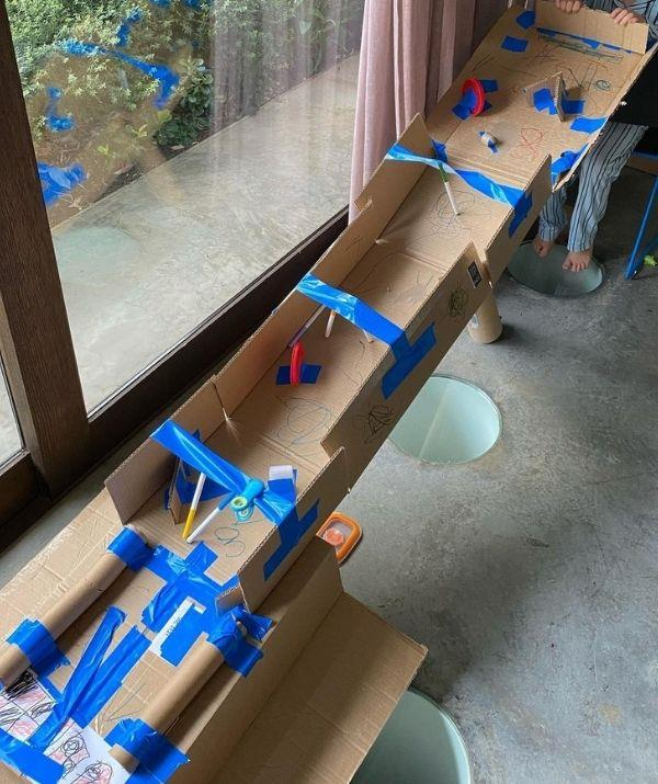 Here is the whopping cardboard racetrack made exclusively for easter eggs — which is one of Hamish's many ingenious adventures with the kids.