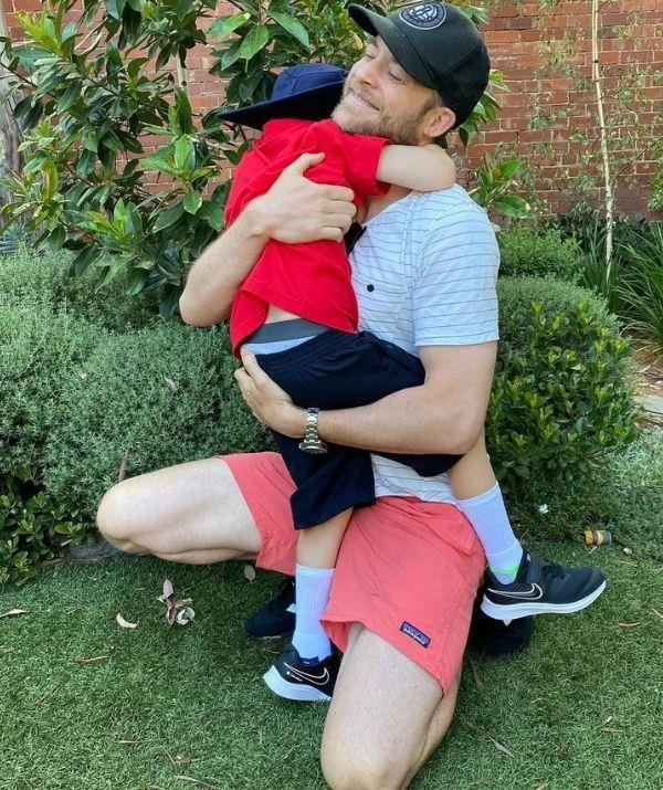 """""""Power hug and suddenly he's off to school! I know everyone says it goes fast but I am genuinely expecting his year 12 results by about next Thursday. #firstdaychamp #healsodidgrea,"""" wrote Hamish."""