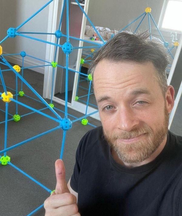 Hamish made this stick fort for his children, and he looks pretty proud of his creation.