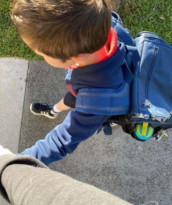 Hamish holding Sonny's hand on the way to school. Our hearts.