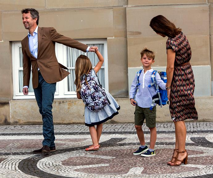 And on the twins' first day of school he simply couldn't resist giving Princess Josephine a twirl!