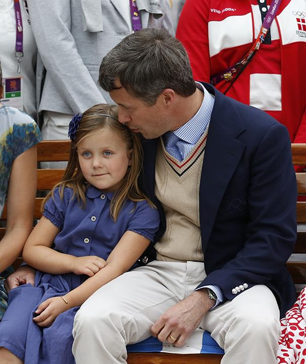 Even with four kids running around, Frederik finds time for each of his children individually. Here he plants a kiss on Isbaella's head during an outing.