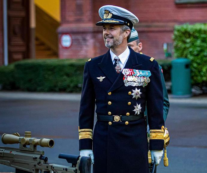 He may be in his 50s, but the future Danish King looks as handsome as ever in his crisp military suit.