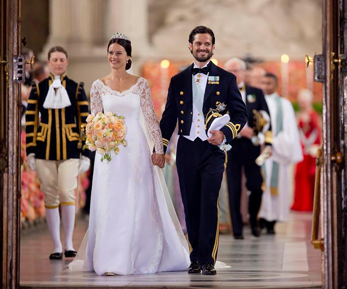 Prince Carl Philip looked like a real-life prince charming on his wedding day, his new wife looking equally divine in a lace wedding dress and sparkling tiara.