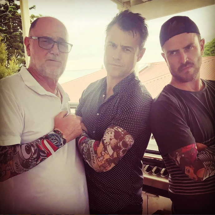 """*Doctor Doctor* star Rodger Corser shared a """"tough"""" shot with his dad and brother, all sporting fake tattoo sleeves. <br><br> """"Happy Father's Day,"""" he wrote. """"You've always lead by example and always taught us to never ever do anything we'll regret later."""" <br><br> """"Campbell and I are just chips of the old block….or perhaps more aptly a couple of Koonunga Hills of the old 389!"""""""
