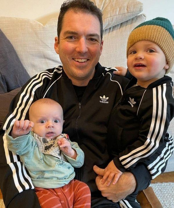 Peter and his two adorable boys smile at the camera.