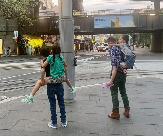 Rafferty took a leaf out of dad's book, carrying one of his sisters through the city while Dave had his other daughter on his back.