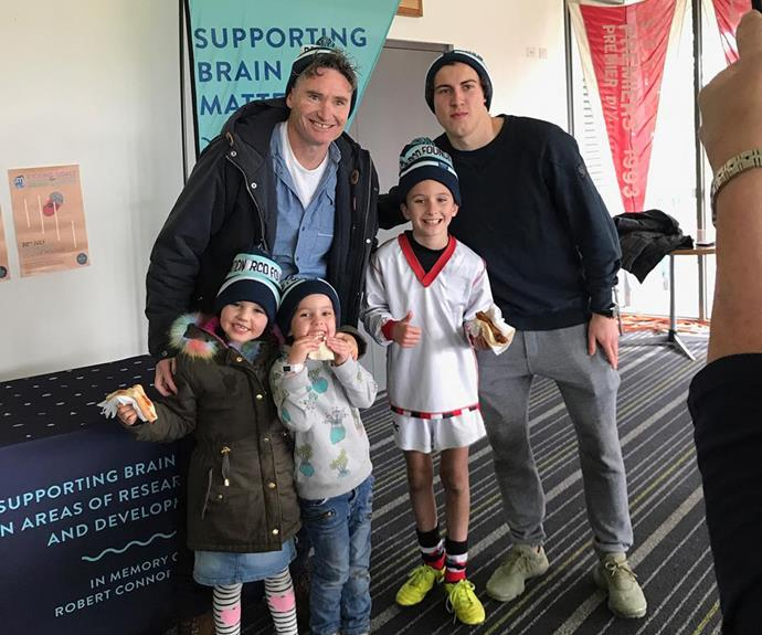 """Hughesy has shared his passion for charity with his kids from a young age, sharing this photo with the caption: """"My lot with snags and @rcdfoundation beanies."""""""