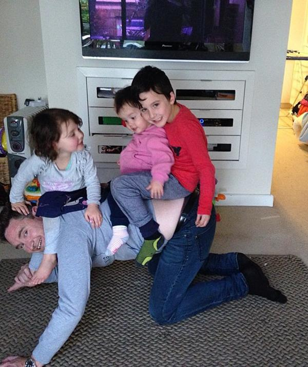 At home, Hughesy loves playing the role of dad, as seen by his willingness to let all three kids hop on his back and muck around.