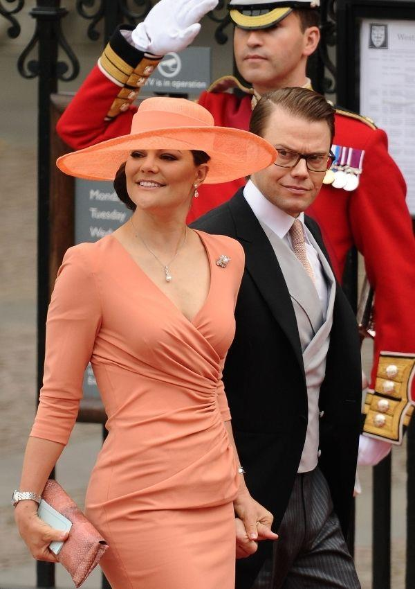 **Princess Victoria and Prince Daniel of Sweden attending Prince William and Kate Middleton's wedding** <br><br> Princess Victoria opted for a fitted tangerine dress for the monumental day.