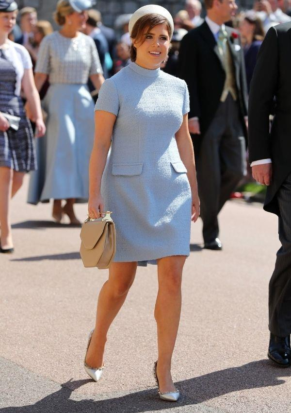 **Princess Eugenie attending Prince Harry and Meghan Markle's wedding** <br><br> Princess Eugenie wore this 1950s inspired number with an elegant hat.