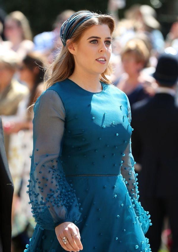 **Princess Beatrice attending Prince Harry and Meghan Markle's wedding** <br><br> Princess Beatrice opted for a teal dress with adornments added for texture.