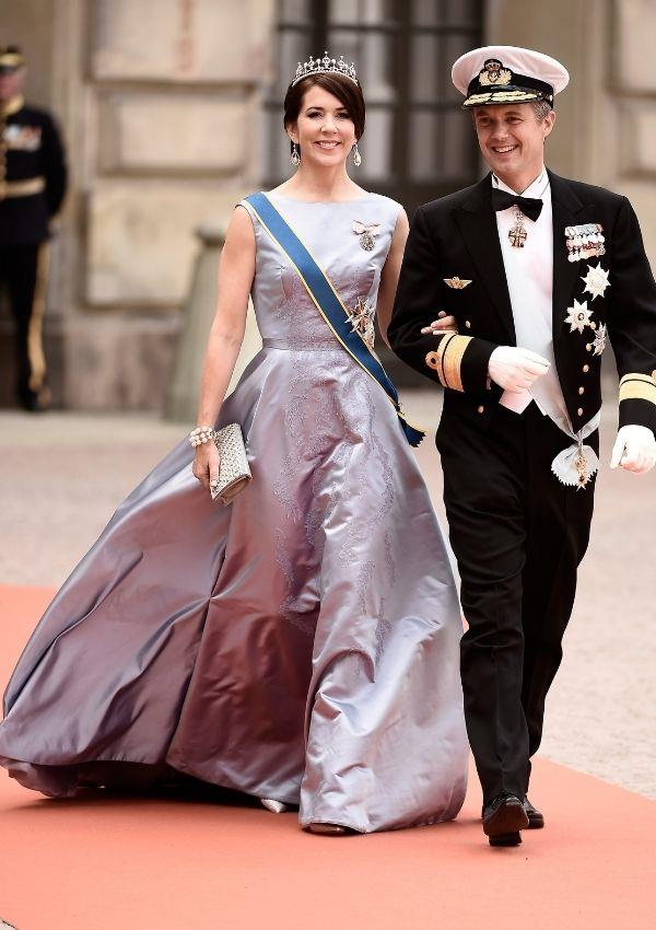**Princess Mary and Prince Frederik of Denmark attending Prince Carl Philip of Sweden and Sofia Hellqvist's wedding** <br><br> This gown is inarguably one of Princess Mary's most iconic dresses to his day.