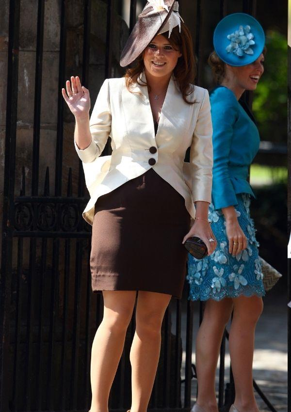 **Princess Eugenie attending Zara Tindall and Mike Tindall's wedding** <br><br> Although the wedding took place in 2011, her brown and cream outfit looks inspired by the '90s.