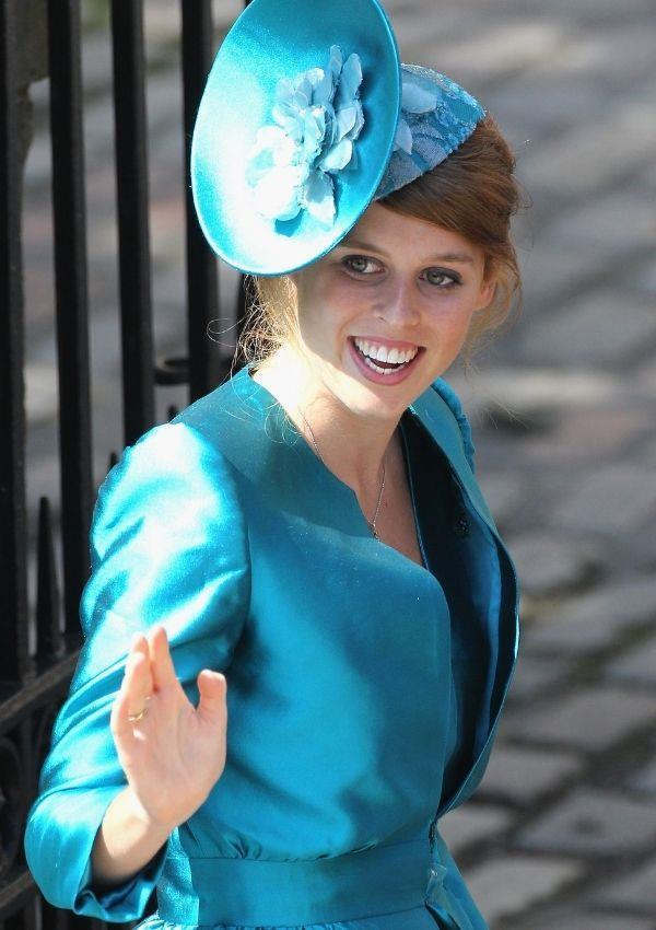**Princess Beatrice attending Zara Tindall and Mike Tindall's wedding**  <br><br> Princess Beatrice loves her blues, and her saucer hat is niche.