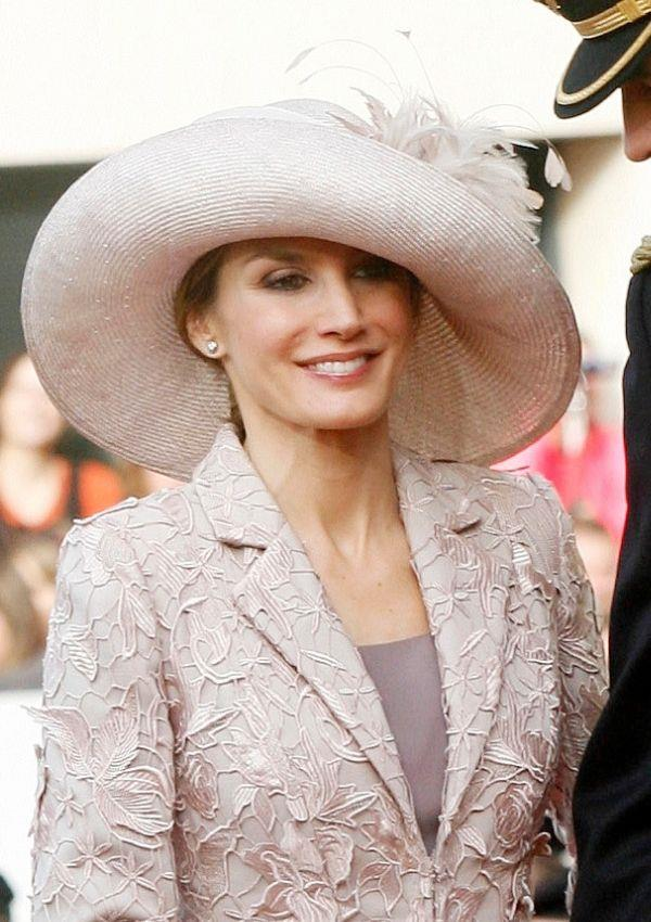 **Queen Letizia of Spain attending Prince Guillaume of Luxembourg and Countess Stephanie de Lannoy's wedding**  <br><br> Despite wearing such an enormous hat, Letizia's beauty still shined through with ease.