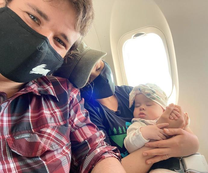 """All tuckered out after her first big family holiday, Grace cuddled up for a nap in her mum's arms on the flight home. Bindi wrote: """"Beyond proud of our girl. She was happy and smiling the entire time and enjoyed all the snuggles."""""""