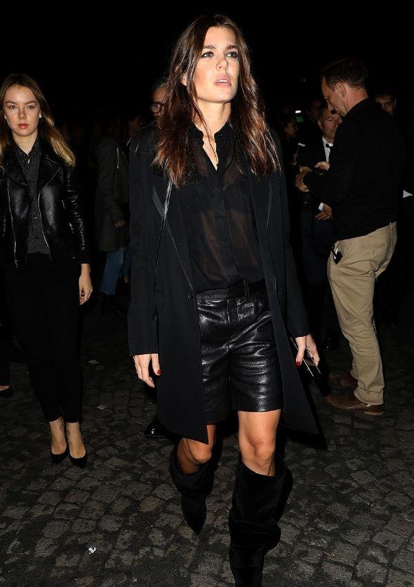 A sheer top with a black bra, leather shorts, a back coat and knee-high black boots - how can we steal this look!? Charlotte wore this rockstar outfit that Jane Birkin would have snatched up to the Saint Laurent show in 2017.