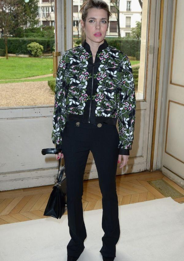 For the Giambattista Valli fall/winter show in 2017, Charlotte paired a slightly flared black pant with a graphic patterned bomber jacket. Considering her outerwear piece is such a statement, it speaks for itself.