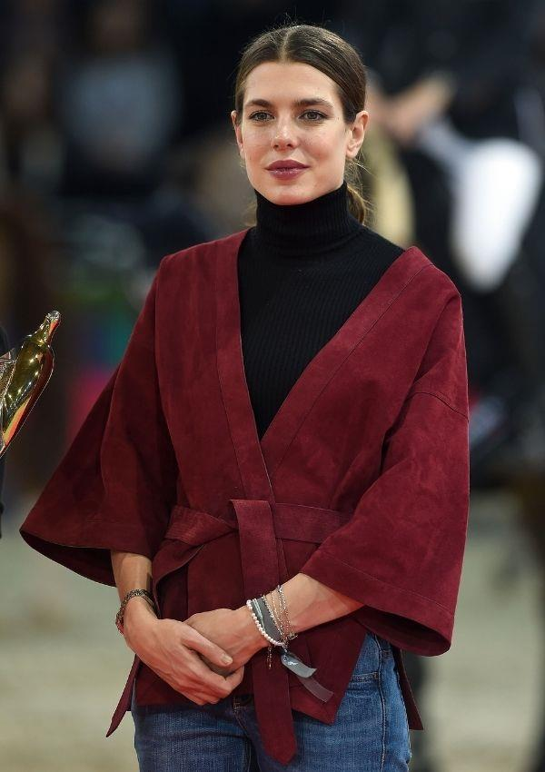 Understated but oh so deliciously stylish: Charlotte paired this Japanese kimono style jacket with a sleek black turtleneck to attend a Gucci event in 2014.
