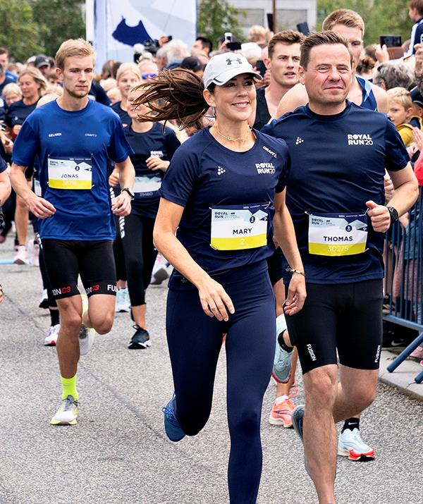 Princess Mary was snapped running with locals in Aalborg.